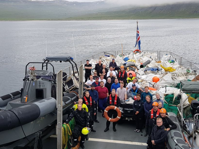 Volunteers and the crew of the Icelandic Coast Guard ship, ...