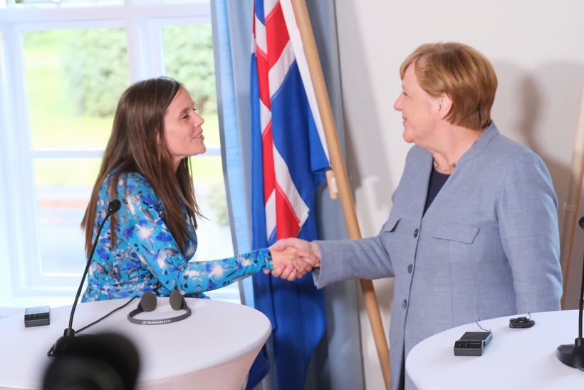 Prime Minister Katrín Jakobsdóttir and German Chancellor Angela Merkel shake ...