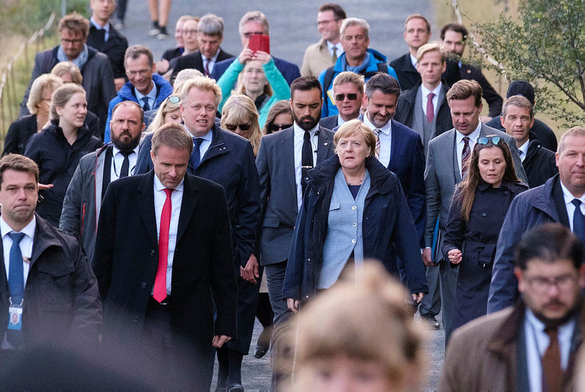 The leaders on their way to the press conference.