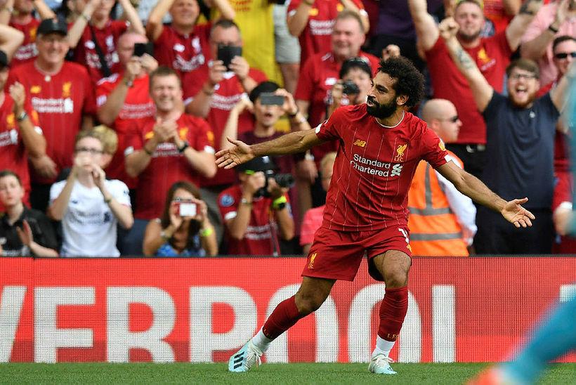 Mohamed Salah fagnar glæsilegu marki sínu gegn Arsenal.
