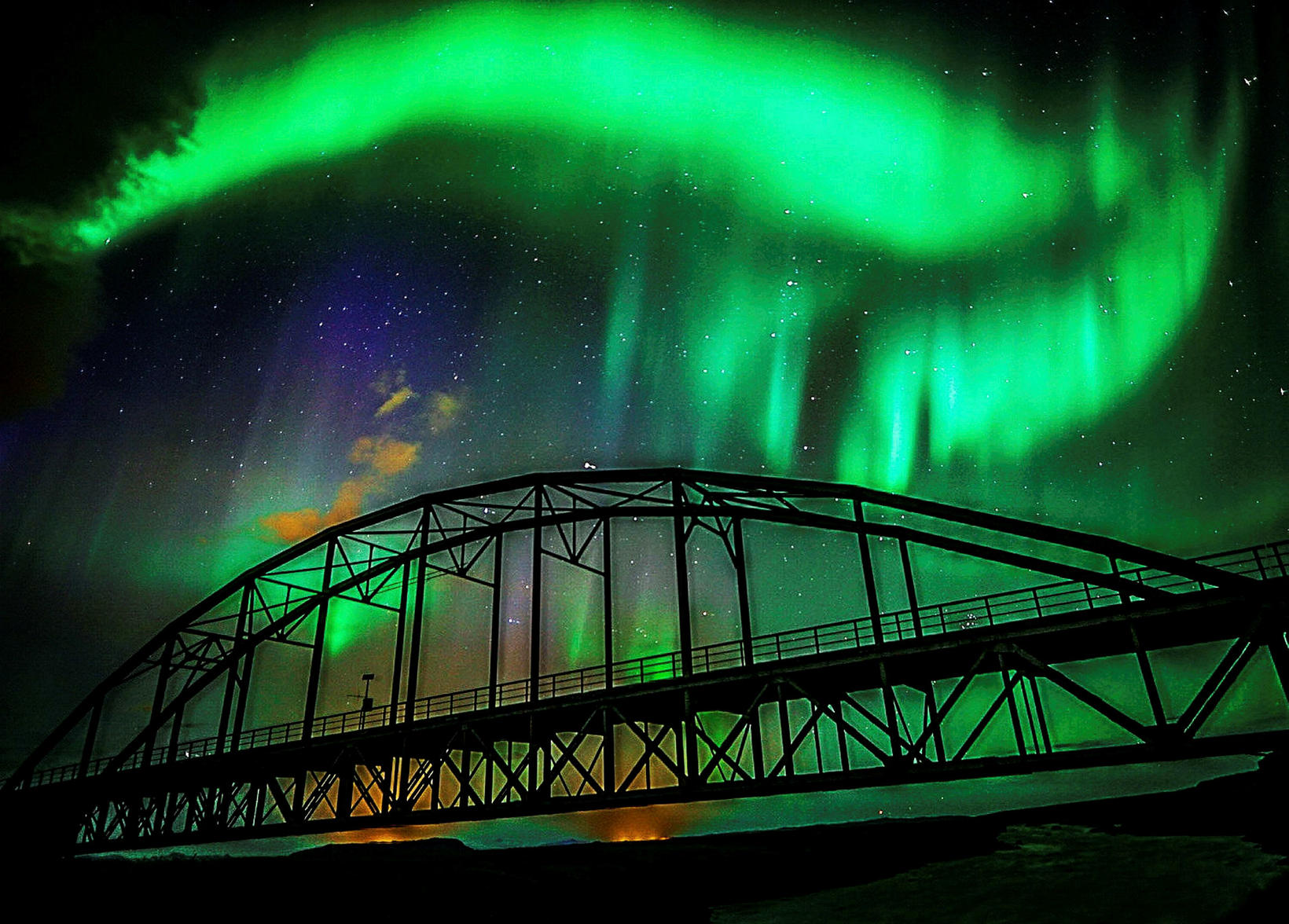 The northern lights, seen from the old Þjórsárbrú bridge, South ...