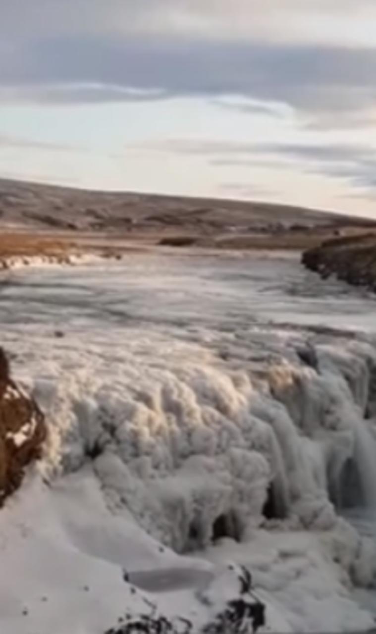 Screenshot from the video of ice breaking free in Kolugljúfur …