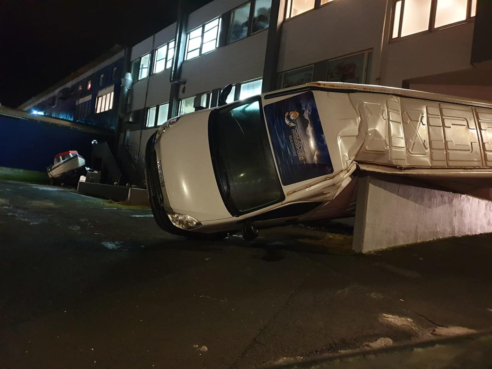 This van in Vestmannaeyjar landed on a wall.