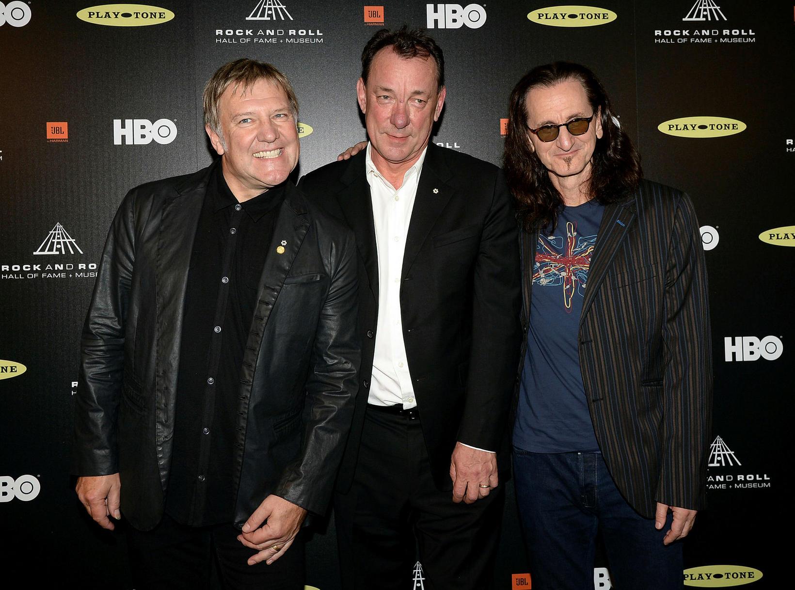 Liðsmenn Rush árið 2013. Alex Lifeson, Neil Peart og Geddy …