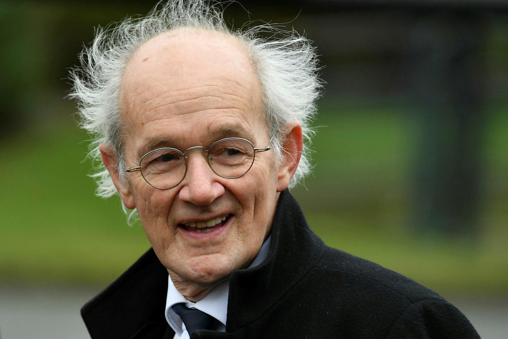 John Shipton, faðir Assange, fylgdist með málflutningnum af áhorfendapöllum.
