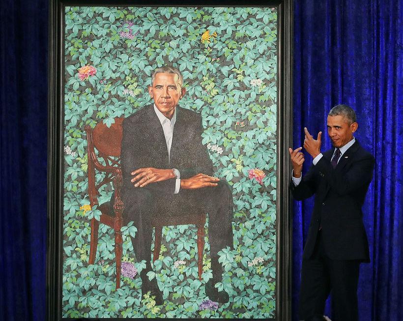 Obama er sáttur við útkomuna eins og sjá má.