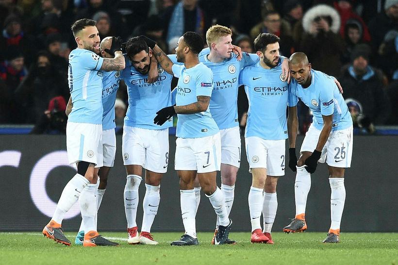 Leikmenn Manchester City fagna einu af fjórum mörkum sínum gegn ...