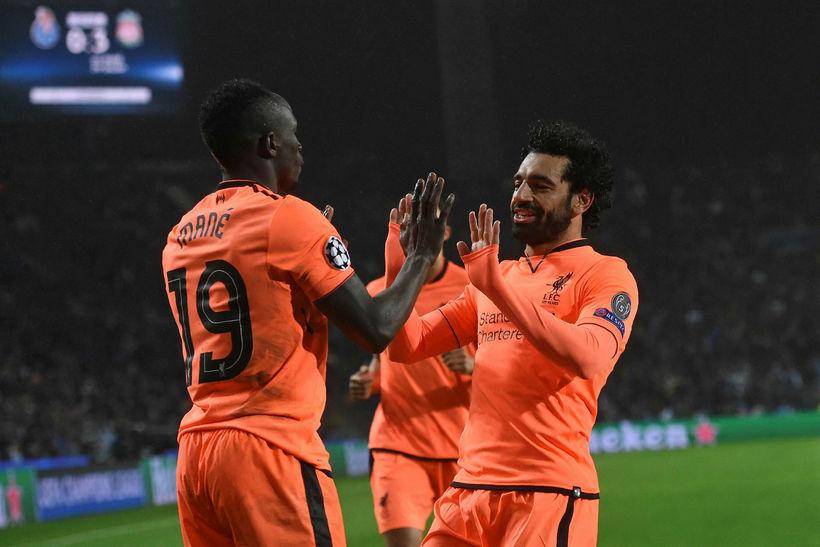Sadio Mané og Mohamed Salah fagna einu af mörgum mörkum ...