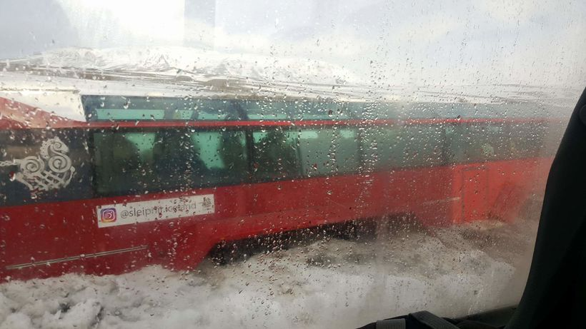 The glacier bus stuck in ice.