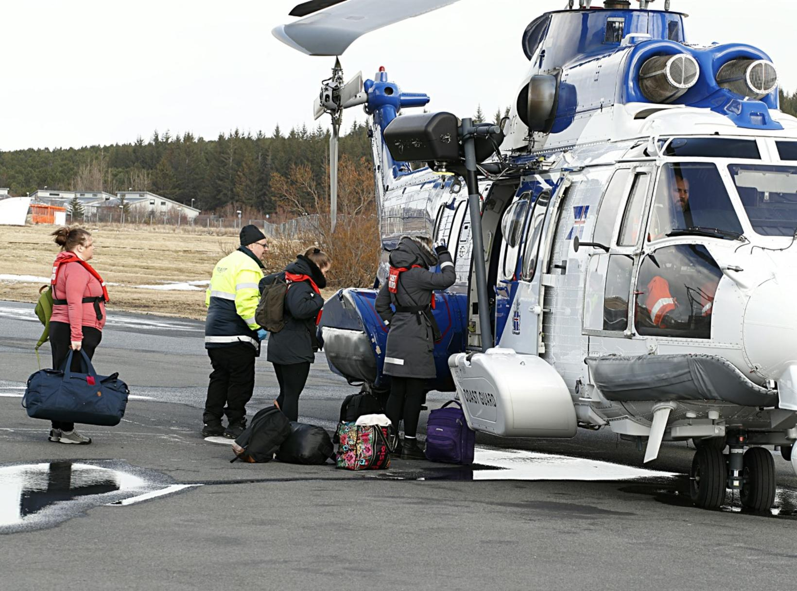 Health care workers, boarding the Icelandic Coast Guard helicopter.