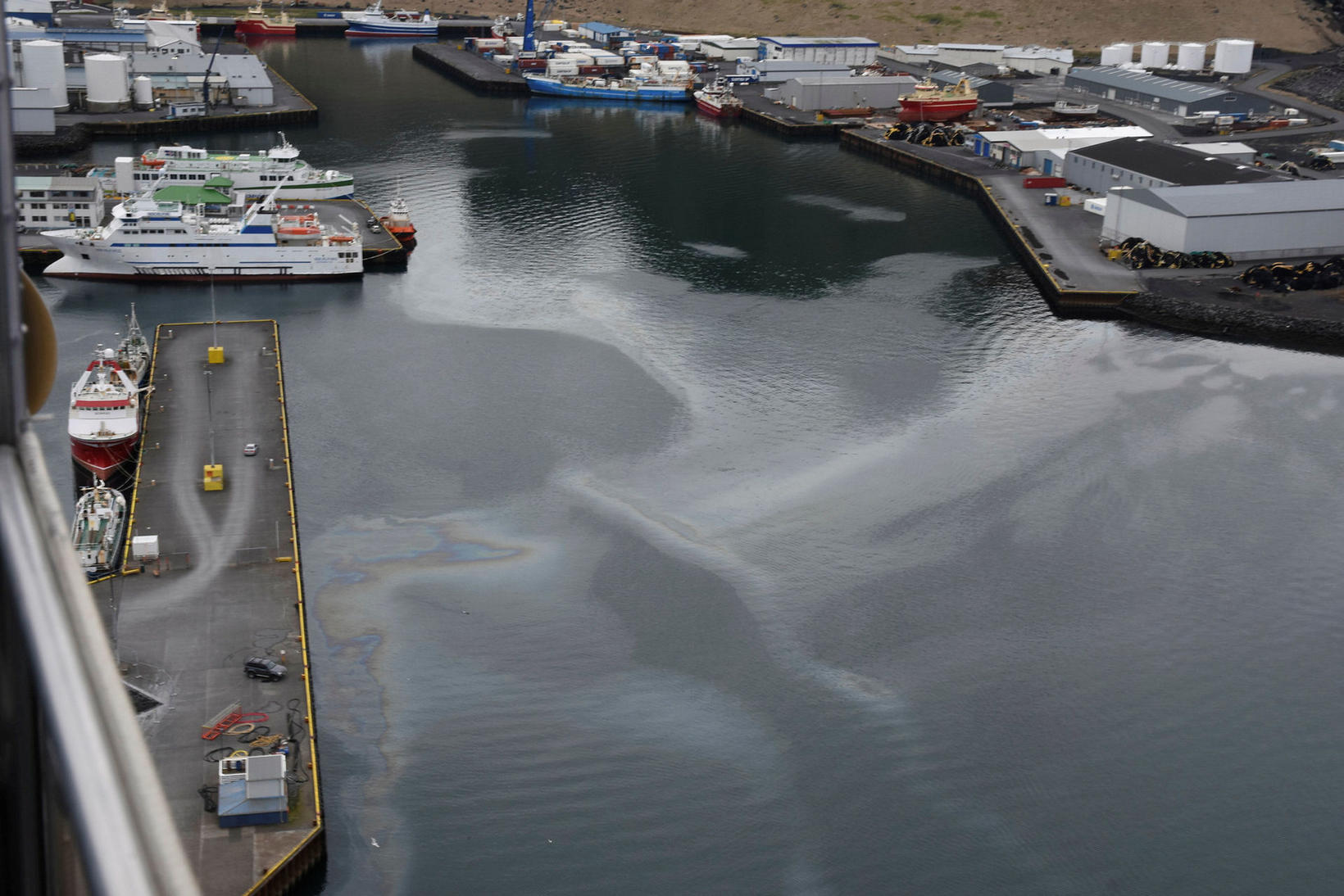 Vestmannaeyjar harbor. The oil slick is obvious.
