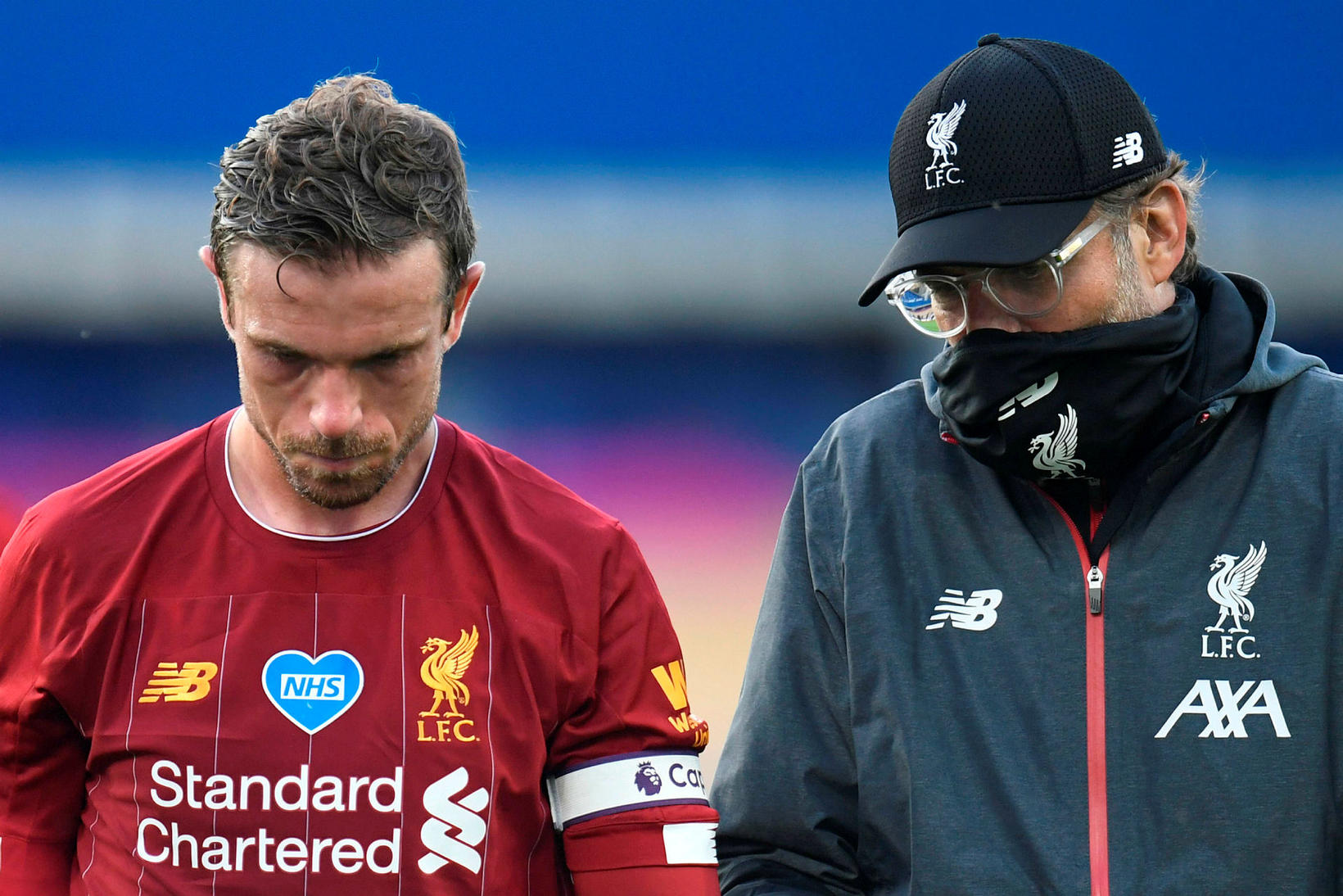 Jordan Henderson, fyrirliði Liverpool, ásamt knattspyrnustjóranum Jürgen Klopp.
