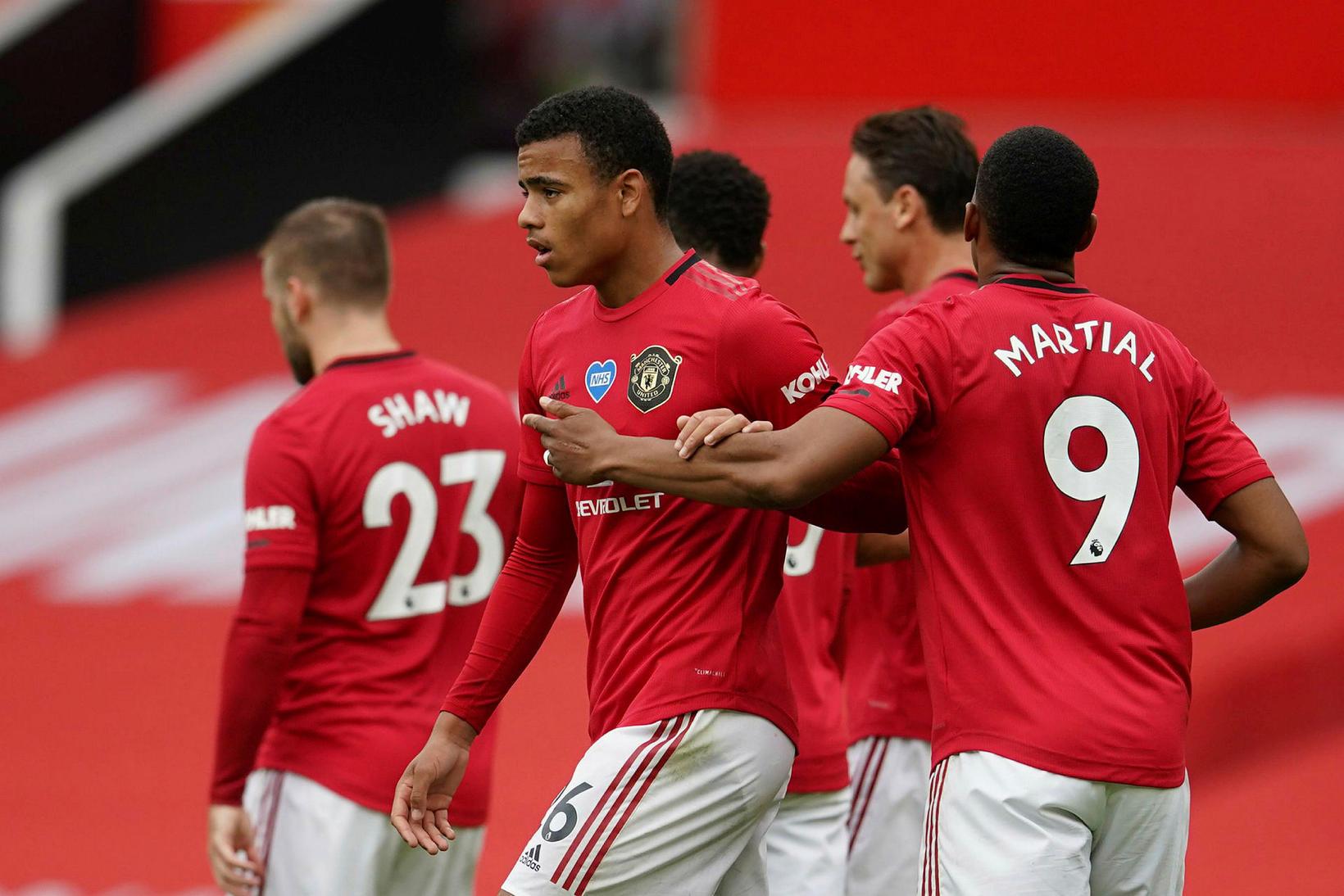 Leikmenn Manchester United fagna einu af fimm mörkum sínum gegn …