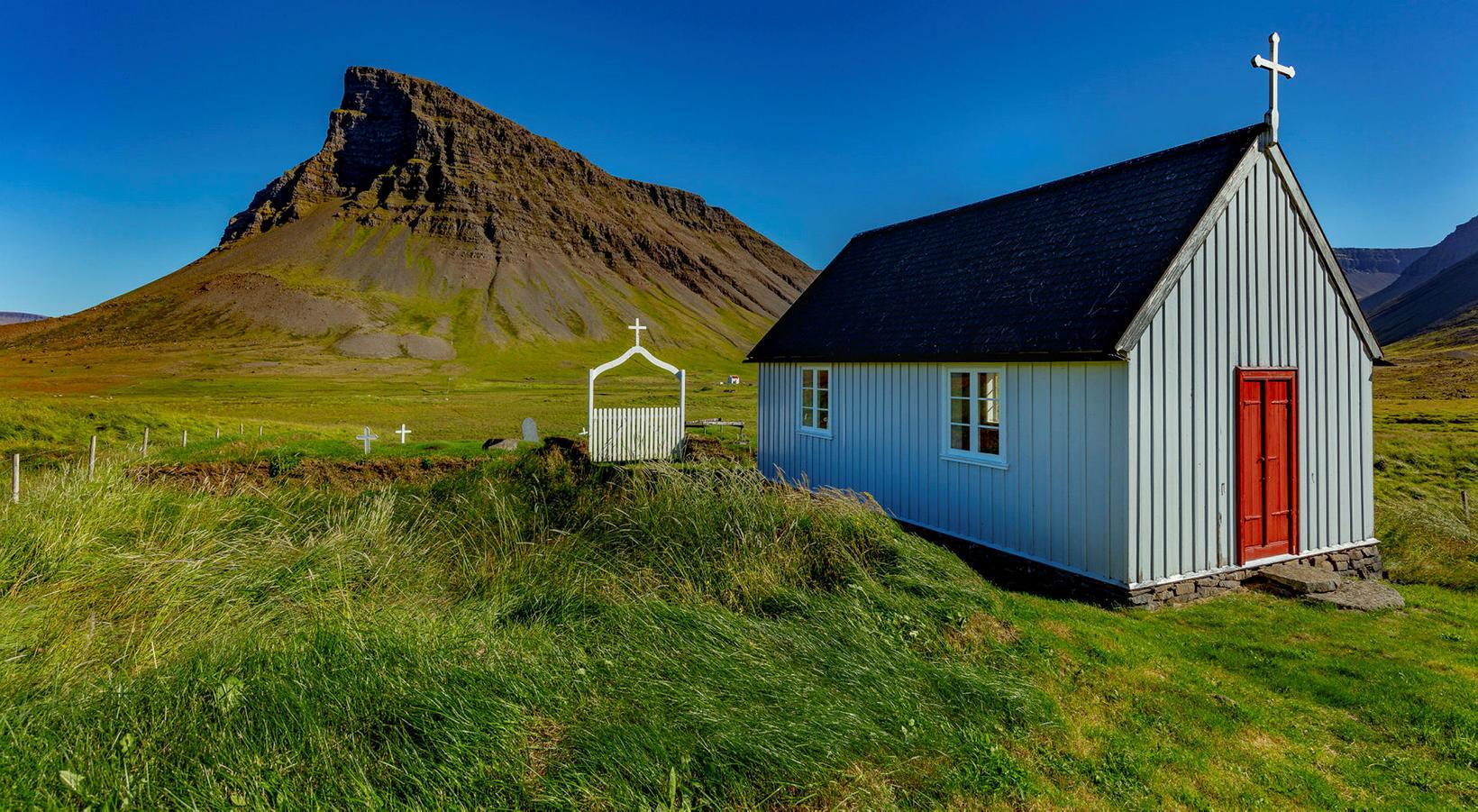 Hraunskirkja church in Keldudalur, Dýrafjörður fjord. Arnarnúpur mountain in the …
