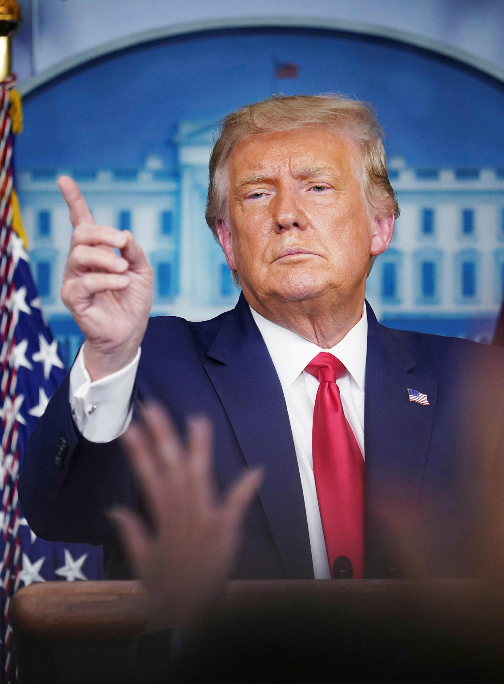 Trump á blaðamannafundi í gær.