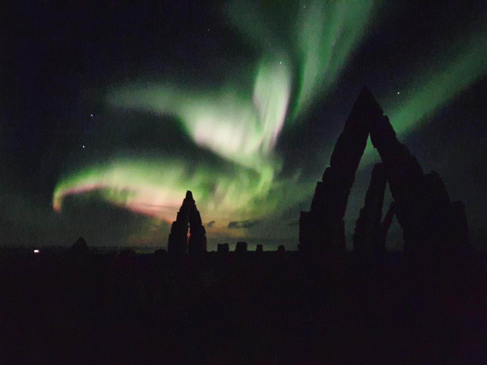 The northern lights, with the Arctic Henge in the foreground.