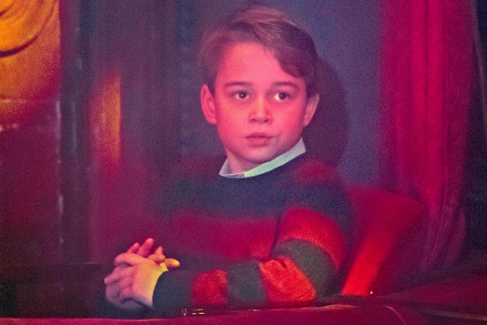 Georg var í peysu frá Ralph Lauren.