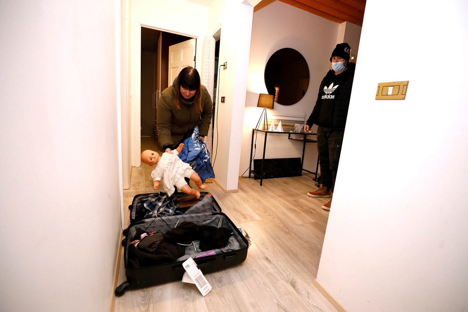 A family collecting their belongings.