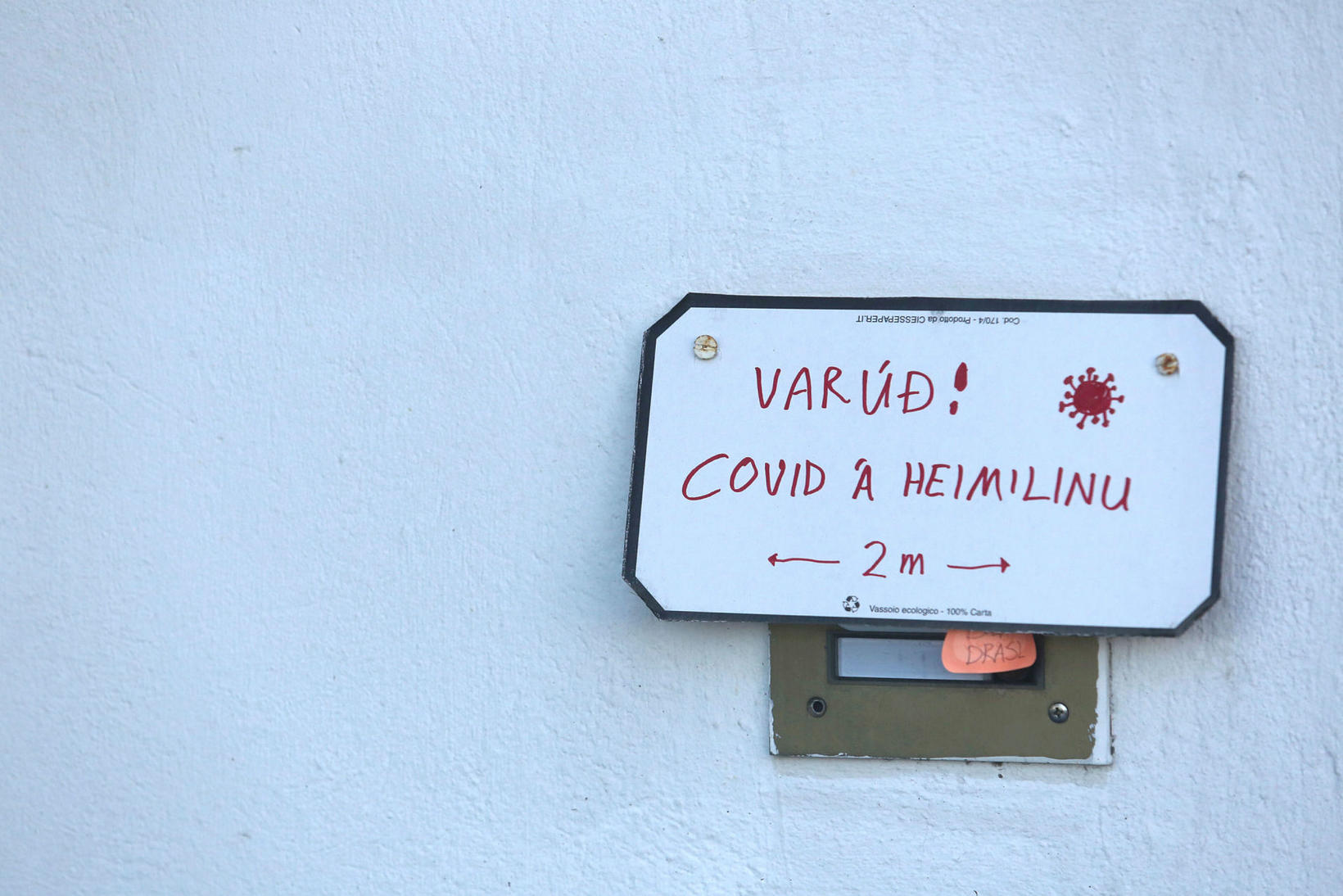 """The sign reads: """"Warning! COVID-infected home. 2 m."""