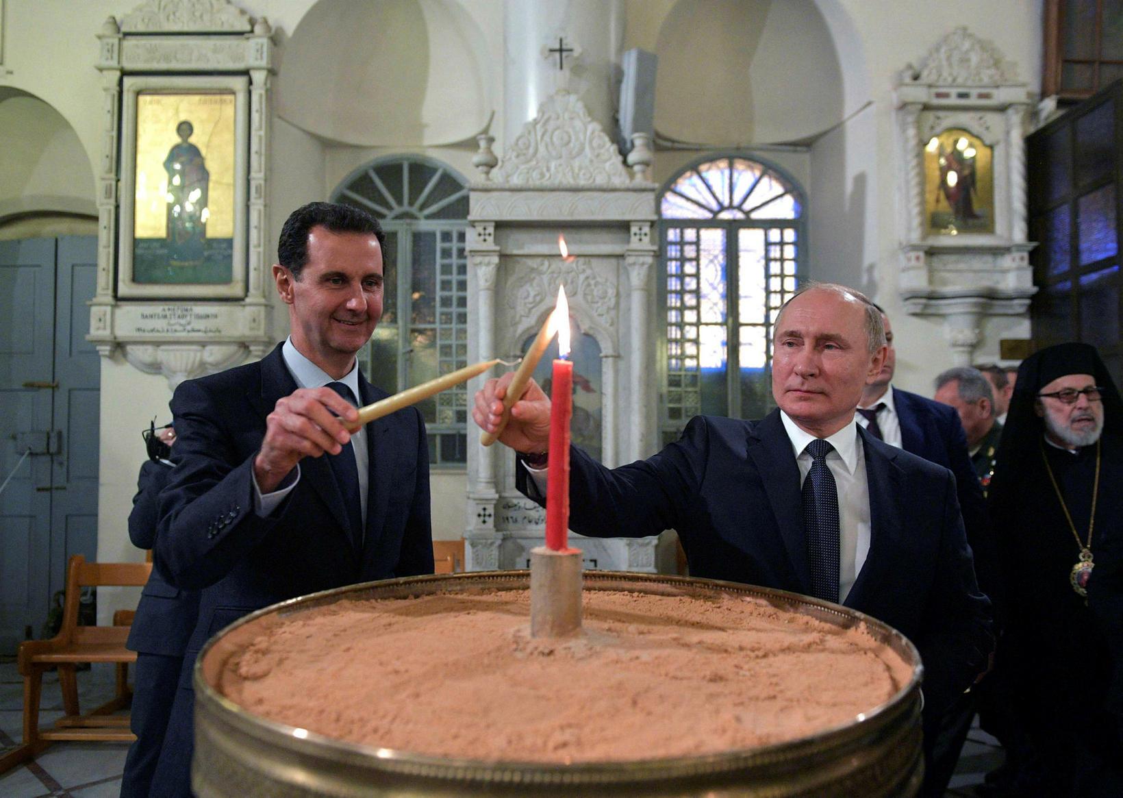Bashar al-Assad og Vladimír Pútin saman í rétttrúnaðarkirkju í Damaskus.
