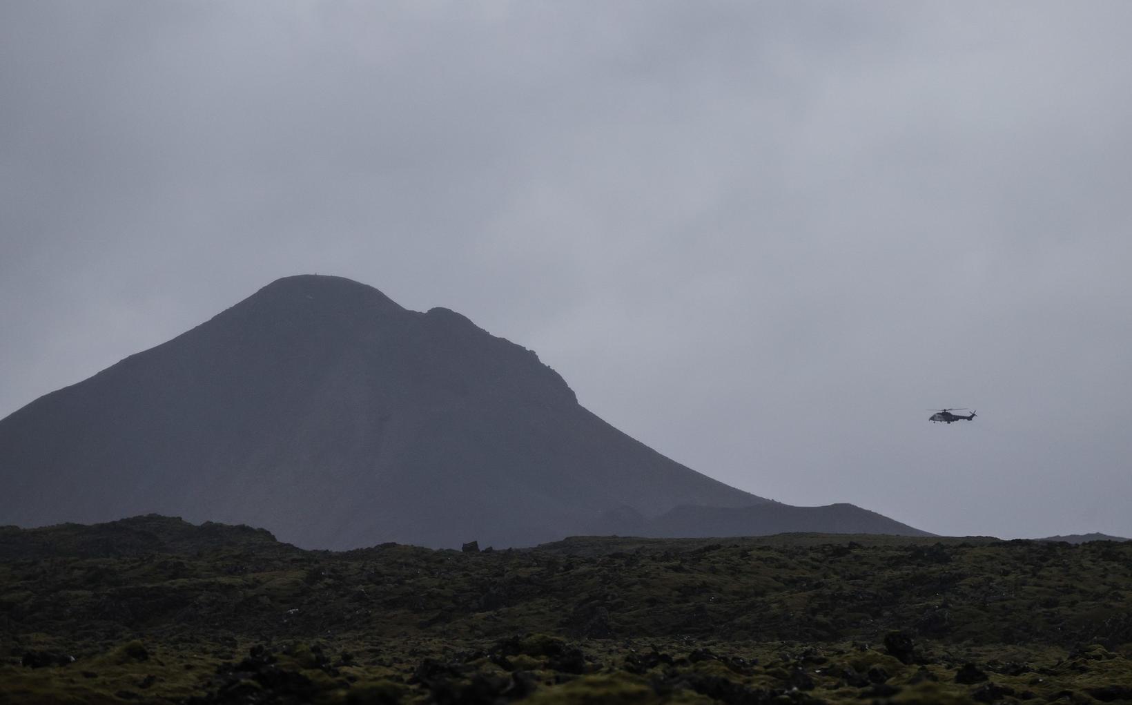 Þyrla Landhelgisgæslunnar við leit fyrr í dag.