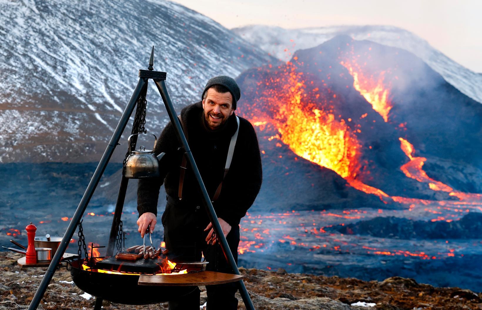 Chef Völundur Snær Völundarson demonstrates how to cook near a …