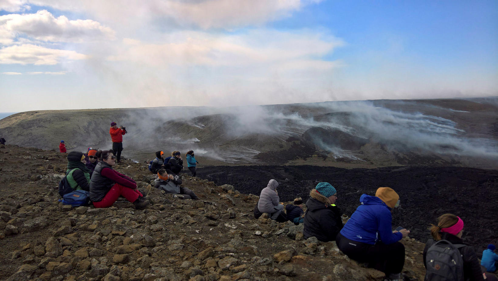 From the eruption site. The smoke in the distance is …