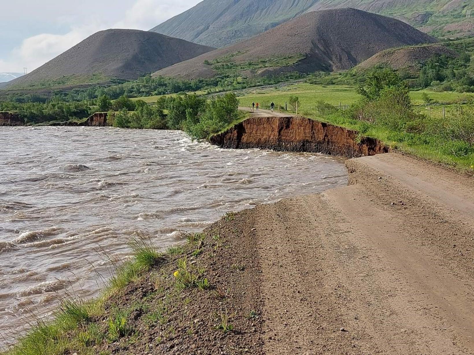 The road along Fnjóská river is damaged by flood.