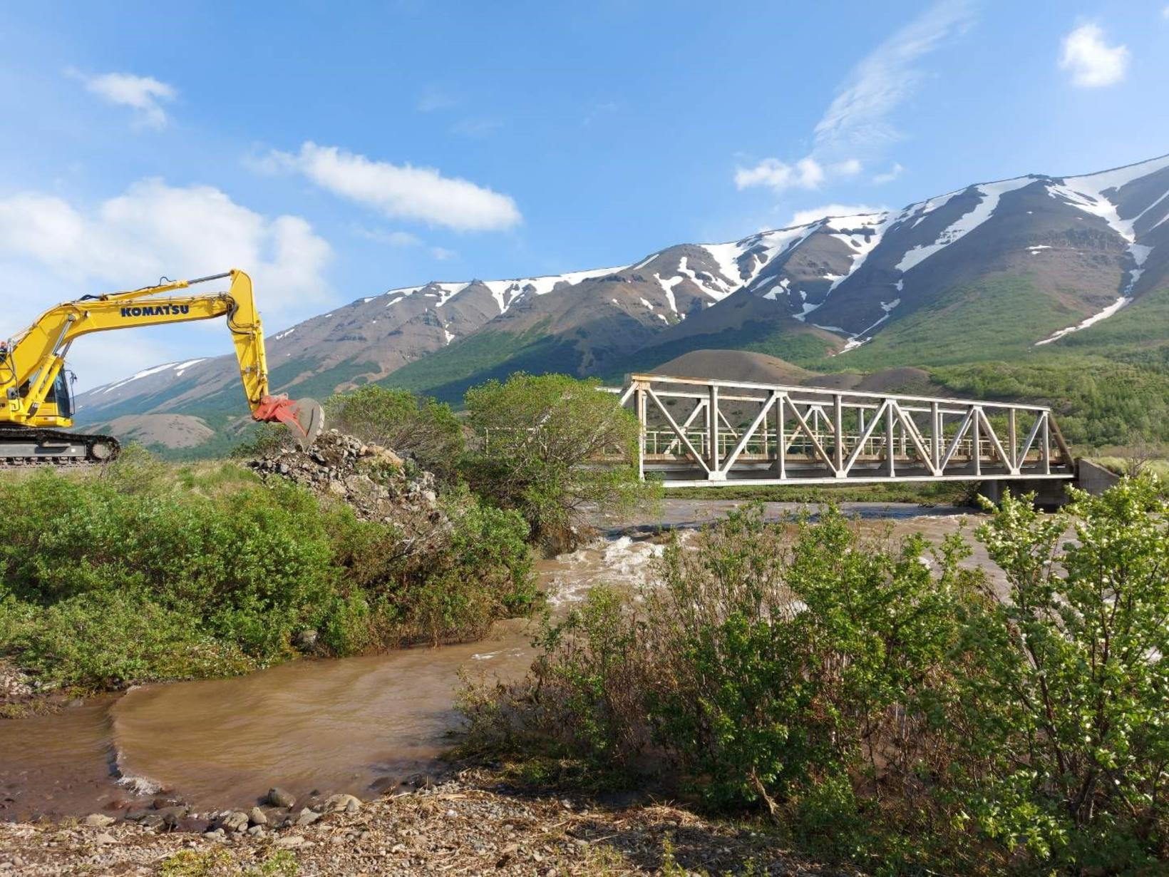Using heavy equipment to try to protect the bridge over …