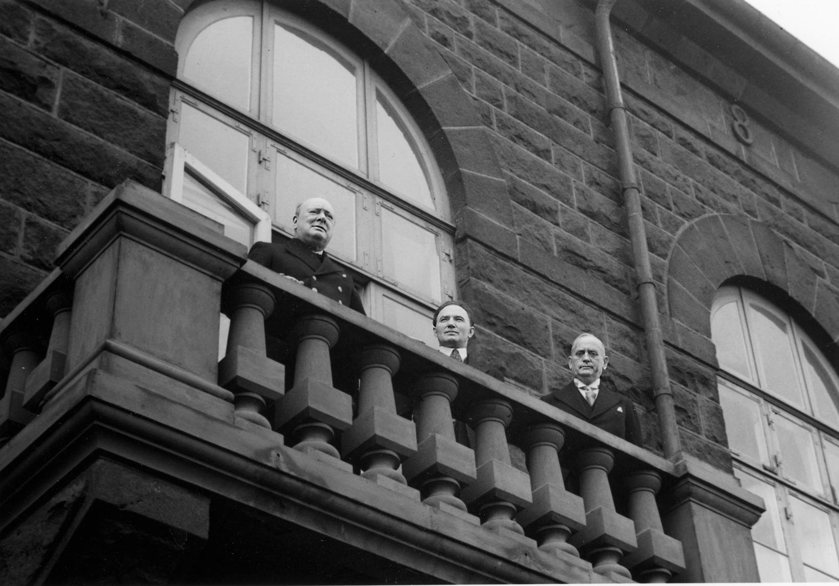 British PM Churchill addresses the crowd gathered in front of …