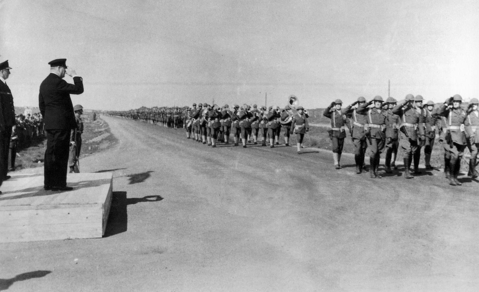 Military parade on Suðurlandsbraut road.