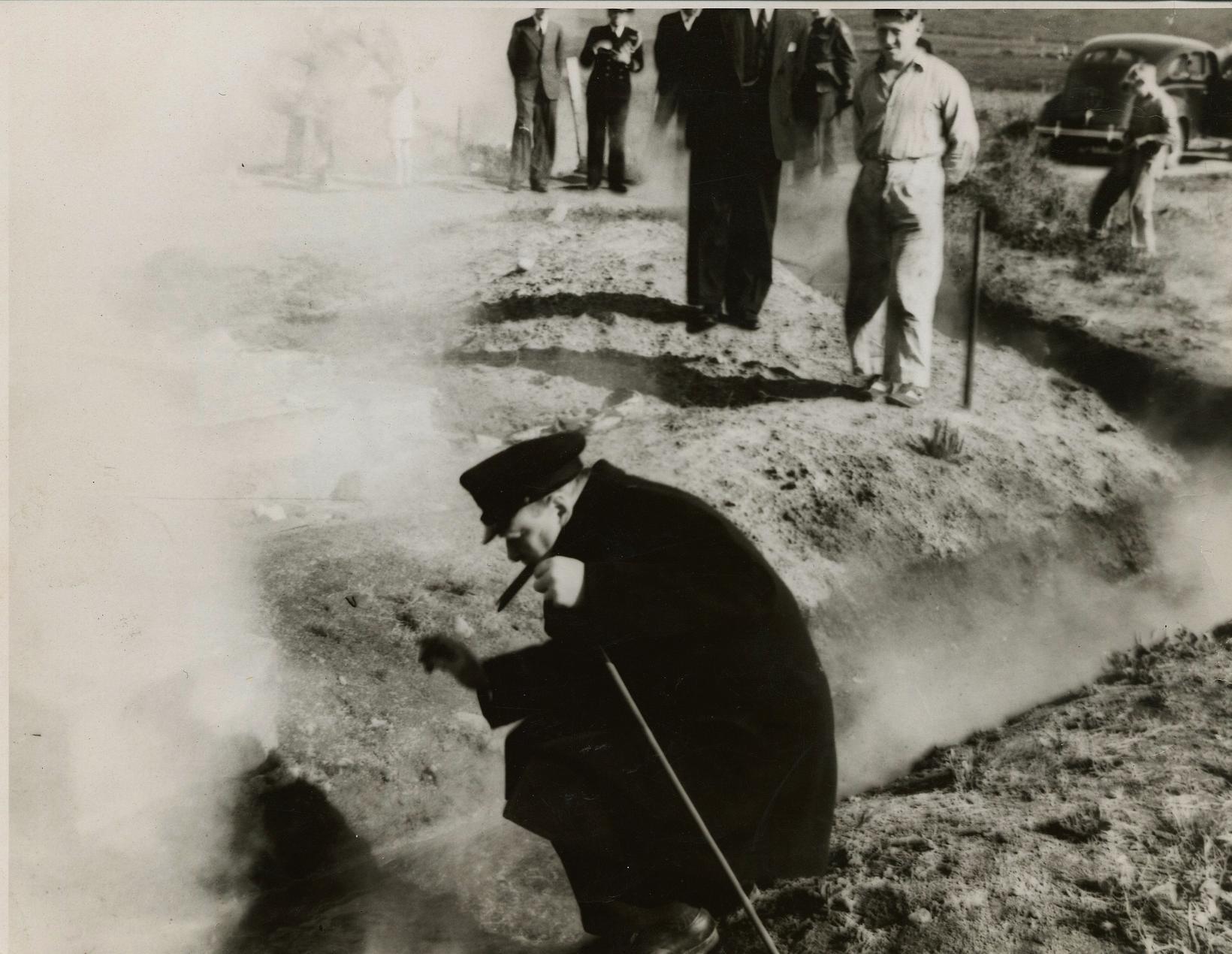 PM Churchill examining the hot springs at Reykir.