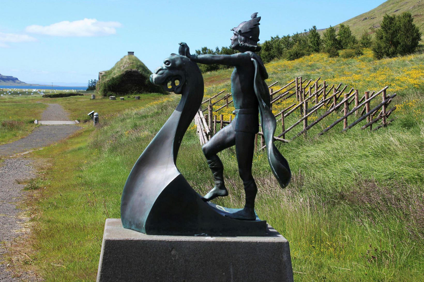 A statue of Leif the Lucky, located near the farm, …
