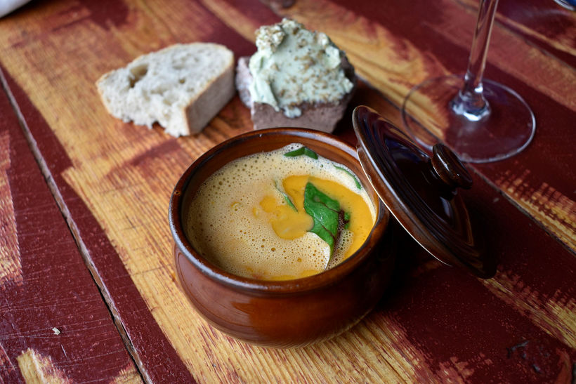 Stone crab soup and artistic butter.