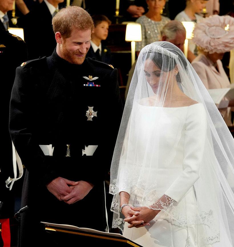 Meghan var í kjól frá Givanchy þegar hún og Harry …