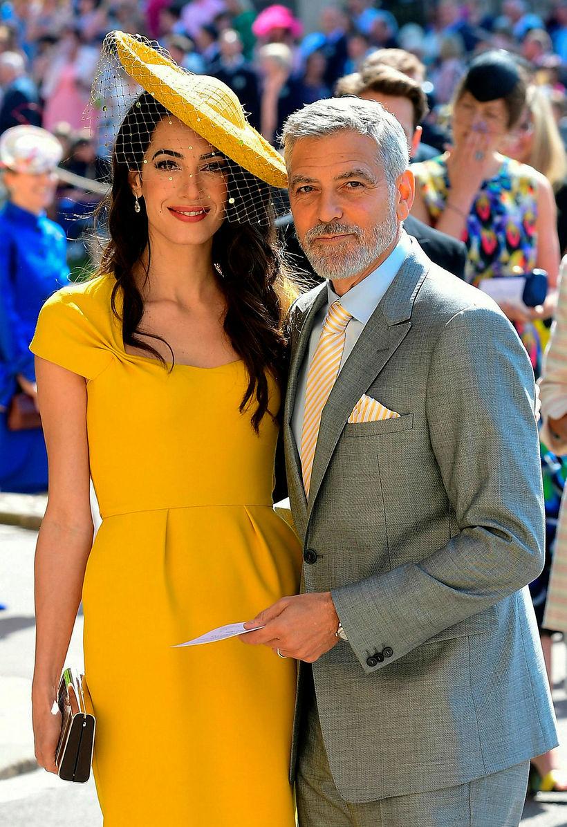 Amal Clooney þykir afar smekkleg en hún valdi gult fyrir ...