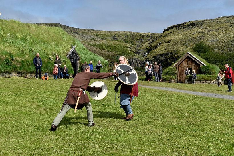 Vikings fighting at the Commonwealth farm; Olly's village in season ...