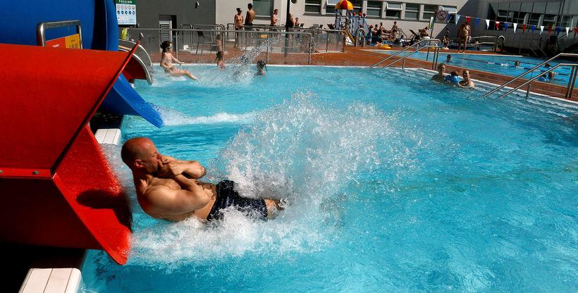 People relaxing at Akureyri swimming pool.