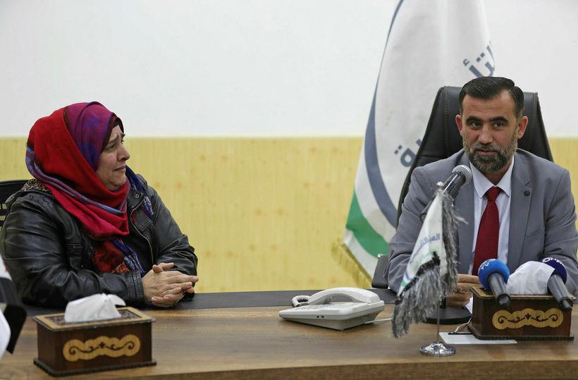 Nancy Roxana Papa ásamt Bassam Sahiouni sem er einn þeirra ...