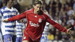Fernando Torres fagnar einu af þremur mörkum sínum gegn Reading ...