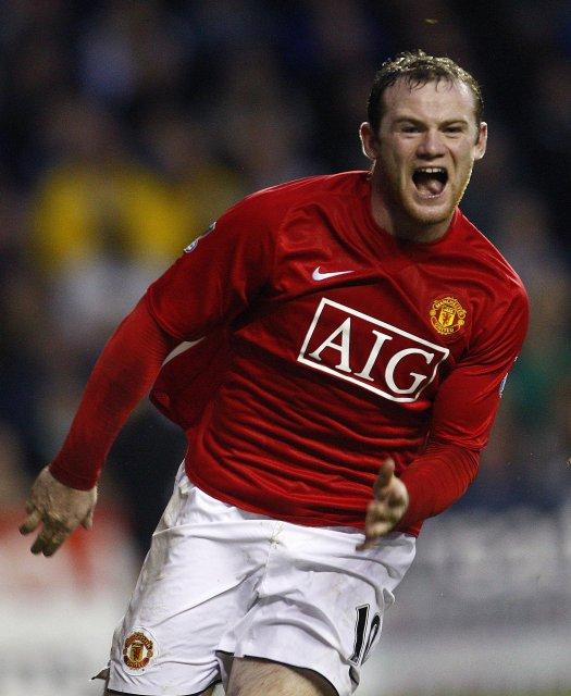 Wayne Rooney fagnar marki sínu.