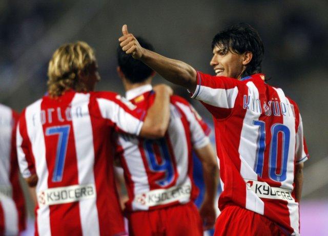 Liðsmenn Atletico Madrid fagna sigrinum í kvöld.