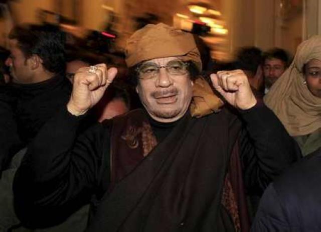 Múammar Gaddafi.