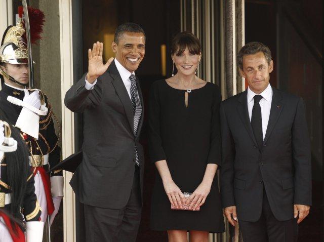 Obama skrifaði undir lögin frá Frakklandi með aðstoð fjarstýrðrar undirskriftarvélar.