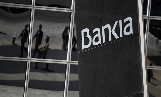 Spænska ríkið hefur þjóðnýtt Bankia bankann en hann var umsvifamikill ...