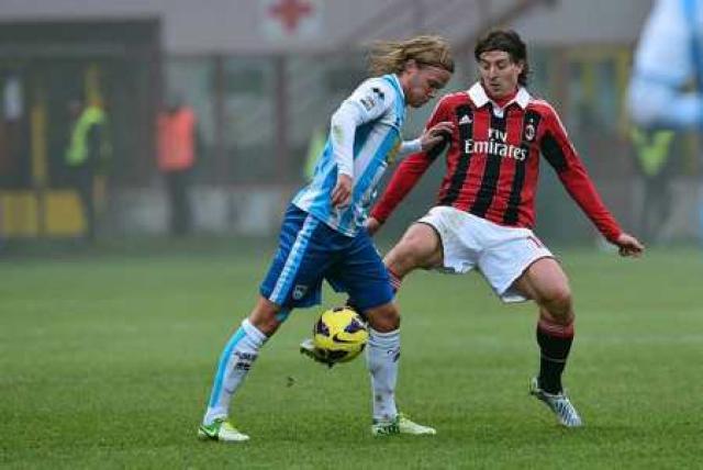 Birkir Bjarnason í leik gegn AC Milan.