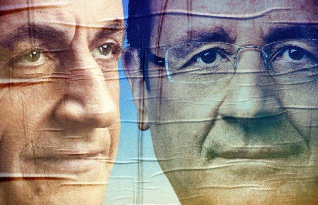 Veggspjald með andlitum Nicolas Sarkozy, forseta Frakklands, og Francois Hollande, ...