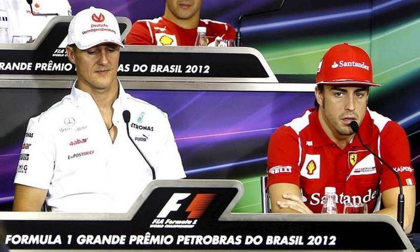 Schumacher (t.v.) sem ökumaður Mercedes og Alonso sem ökumaður Ferrari ...