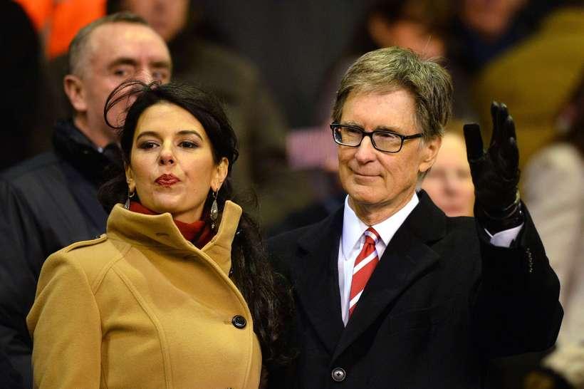 Eigandi Liverpool John W Henry ásamt Lindu Pizzuti konu sinni.