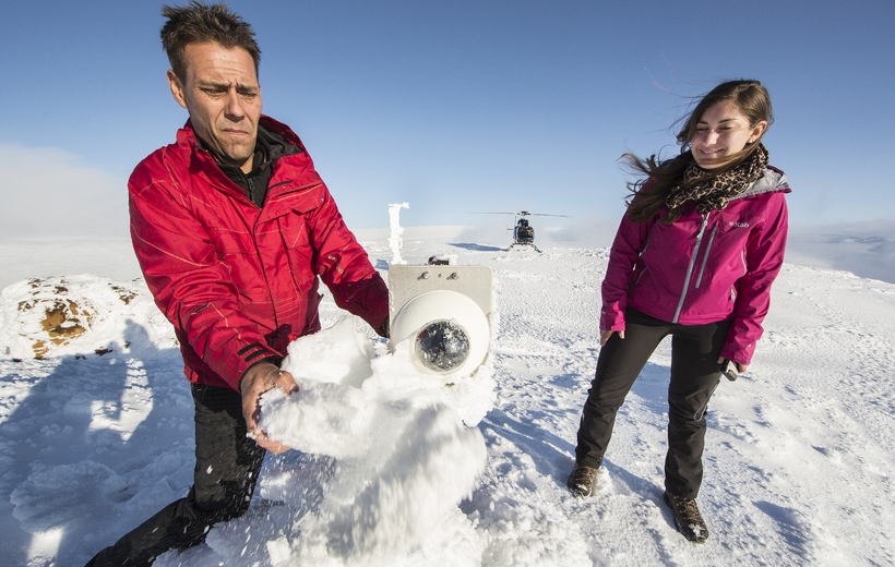 Bjarni Björnsson and Hanna Reynolds wipe snow off the lens ...
